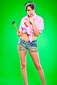 pic of finger-licking  - Sensual girl licking fingers striked by hammer - JPG