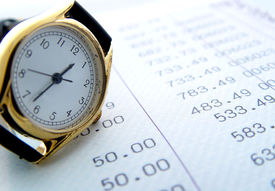 image of time-saving  - watch resting on finance sheet - JPG