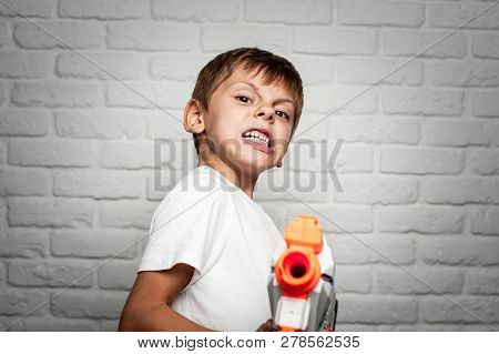 Angry Little Boy With Grimaсe