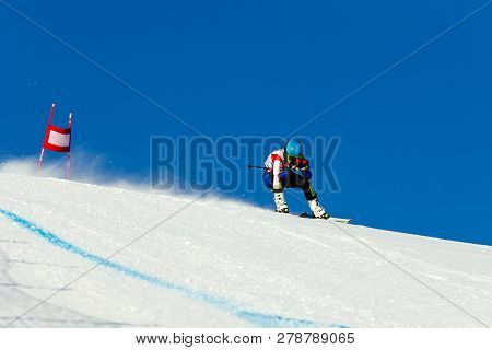 Man Racer In Downhill Skiing
