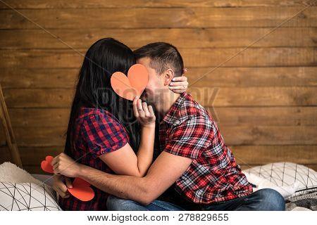Romantic Couple Sitting On A