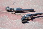 foto of gunfighter  - A Calico Gunfighters pistols lie in the streets of the 1889 Silver boom town of Calico - JPG
