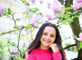 Its Spring Time. Pretty Girl Near Flowering Tree Enjoy Magnolia Blossom. Cute Girl Happy Smiling On  poster