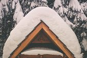 Heavy Snow Weather Concept. Wooden Architectural Element Covered By Heavy Snow. poster
