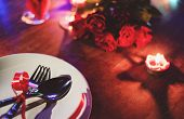 Valentines Dinner Romantic Love Concept / Romantic Table Setting Decorated With Fork Spoon On White  poster