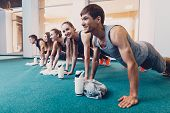 Group Men And Women Performs A Physical Exercise. A Happy Group Of People Performs An Exercise Bench poster