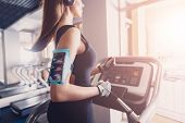 A Girl Performs A God Exercise On A Treadmill. Maintain A Healthy State Of Mind Cardio. Listening To poster