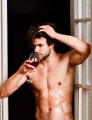 Man With Sexy Torso Drink Wine. Sexy Attractive Macho Tousled Hair Coming Out Through Bedroom Door.  poster