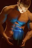 Healthy Diet And Fitness. Man Use Sport Vitamin Supplements For Muscle Building. Sport Nutrition And poster