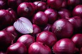 Full Frame Shot Of Purple Onions. Fresh whole purple onions and one sliced onion. poster