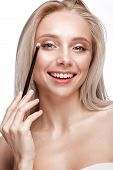 Beautiful Young Girl With A Light Natural Make-up, Eye Shadow Brush And Nude Manicure. Beauty Face. poster