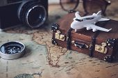 Toy Plane And Suitcase On Vintage Map With Copy Space, Travel Concept poster