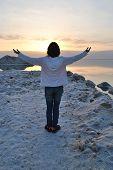A Girl Raising Her Hands Feeling Free, Spirituality, Enjoying Sunrise. Sunrise Over The Dead Sea Sho poster