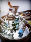 Several Vials And Blood Sample In A Metal Tray, Conceptual Image poster