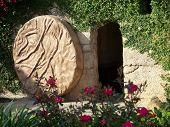 stock photo of jesus  - The Empty Tomb of Jesus with the stone rolled away - JPG