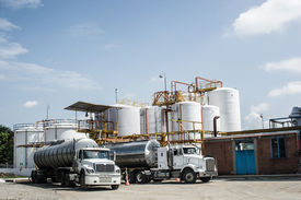 image of tank truck  - Chemical Industry Storage Tank And Tanker Truck In Industrial Plant - JPG