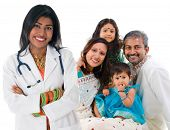 Smiling friendly Indian female medical doctor and patient family. Health care concept. Isolated on w