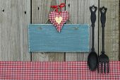 Antique blue sign with heart and cast iron spoon and fork