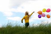 pic of happy kids  - Little girl playing with balloons - JPG