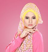 image of muslimah  - Fashion portrait of young beautiful asian muslim woman with pink costume wearing hijab - JPG