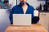 picture of cross-dressing  - Man In Robe Working From Home And Smoking - JPG