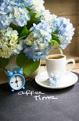 picture of hydrangea  - Hydrangea flowers in a vase cup of coffee and note