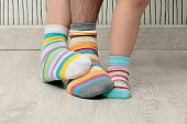 picture of stocking-foot  - feet of a beautiful family with striped socks - JPG