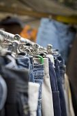 stock photo of thrift store  - clothes on a rack on a flea market.