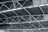 stock photo of roof-light  - Industrial factory ceiling with roof beam and lights - JPG