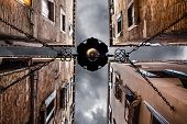 picture of pov  - point of view of a dark alley with gloomy sky in Venice Italy - JPG