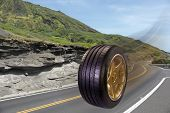 image of long winding road  - This tire rolls down the long winding road - JPG