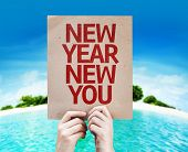 picture of new year 2014  - New Year New You card with a beach on background - JPG