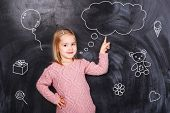 stock photo of little girls photo-models  - Little girl shows her finger on his thoughts - JPG