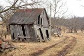 image of shacks  - An old shack on a winter landscape - JPG