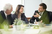 pic of laugh  - Business people laughing during business appointment in the office - JPG
