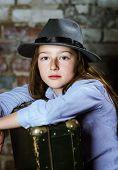 picture of schoolgirls  - Cute schoolgirl portrait with vintage suitcase studio - JPG