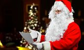image of letters to santa claus  - Santa Claus reading a letter  - JPG