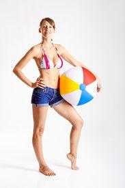 picture of beach-ball  - Beautiful young woman posing in bikini with a beach ball - JPG