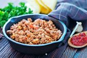 stock photo of tacos  - a bowl of fried ground meat with tomatoes ready for tacos - JPG