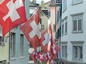 picture of zurich  - Swiss Flags in a Zurich old town street - JPG