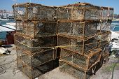 stock photo of lobster trap  - Traps for crabs at the edge of a port - JPG