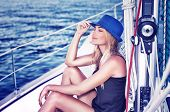 stock photo of relaxing  - Relaxed girl with closed eyes of pleasure sitting on sailboat - JPG