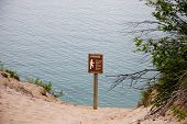 picture of quicksand  - caution sign on the edge of large sand dune - JPG