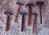 foto of blacksmith shop  - Set of hammers hanging on the wall - JPG