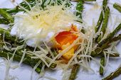 stock photo of benediction  - Benedict egg with grilled asparagus and parmesan - JPG