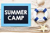 stock photo of starfish  - Summer camp Text written on blackboard with starfish - JPG