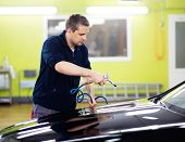 image of pressure-wash  - Man worker drying car on a car wash   - JPG