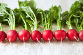 stock photo of food plant  - Clean eating raw radishes on white wooden background - JPG