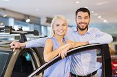 auto business, car sale, consumerism and people concept - happy couple buying car in auto show or sa poster