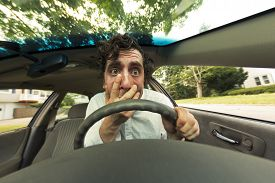 foto of wacky  - Silly man gets into car crash and makes ridiculous face - JPG